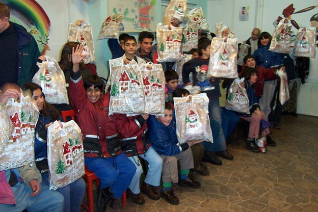 Giving Christmas gifts at an orphanage