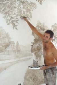 Martin an unemployed carpenter completes the wall murals - Sept 2012
