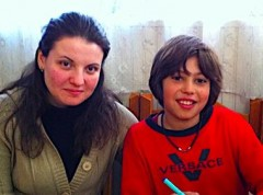 Traian with teacher Stephi - Literacy classes  Dec 2011